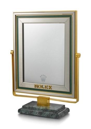 Wrist check in a Rolex mirror