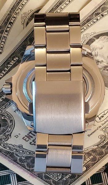 Winner Automatic Watch clasp on monies