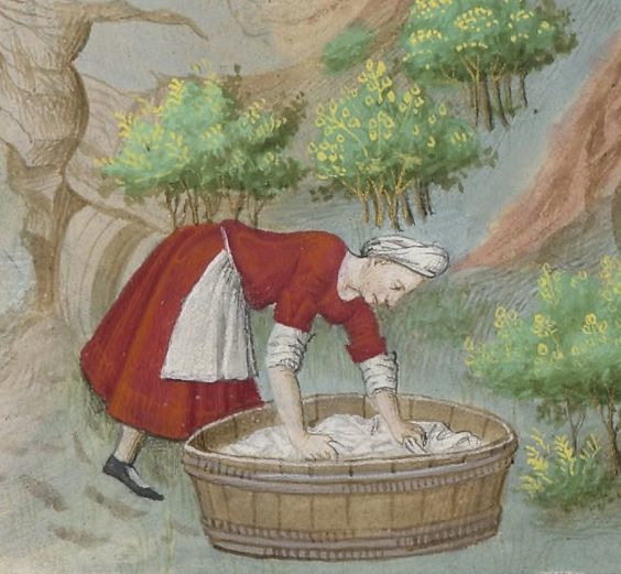 a Tudor laundress at work