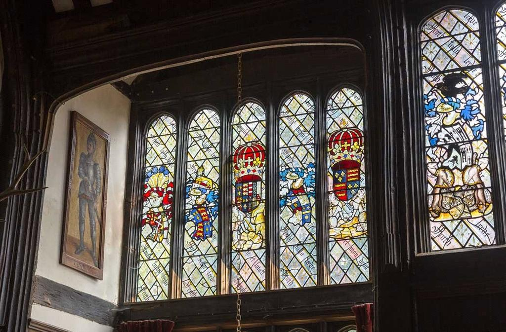 Armourial glass in the great hall at Ockwells