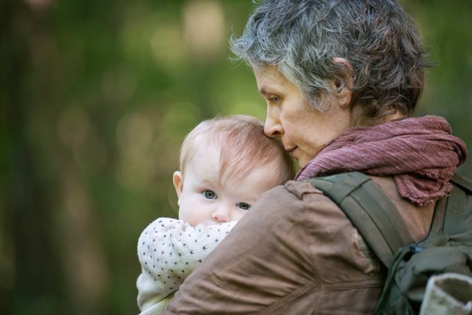 Carol, who lost her own daughter during the first year of the viral attack, holds JUDITH GRIMES. Daughter of Rick and sister of Carl, Judith will never know her mother Lori, who died while giving birth to her child. One could speculate—having not read the graphic novels—if everyone on earth is a potential carrier of the virus, will we discover that Judith has a genome which could turn out to be the nucleus of a cure? BTW: Shane Walsh, Judith's other possible father, will never be forgotten, but for now we go with Rick as Dad of the Year. (Photo by Gene Page - Courtesy of AMC)