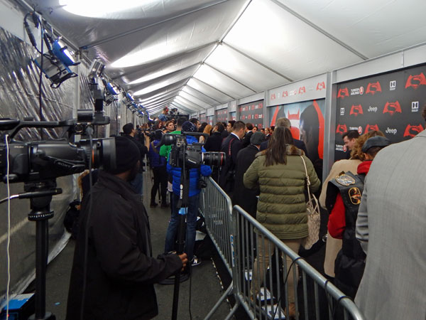 The press pen during the red carpet at the premiere of Batman vs. Superman.