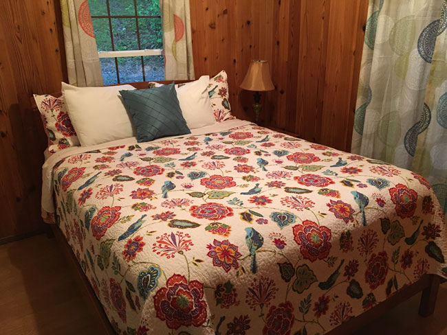 Laurel Cabin bedroom at ACE Adventure Resort.
