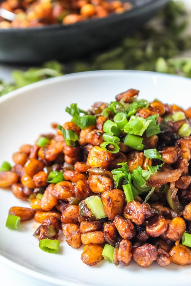 BBQ Nation Crispy Fried Corn on white plate topped with green spring onions.