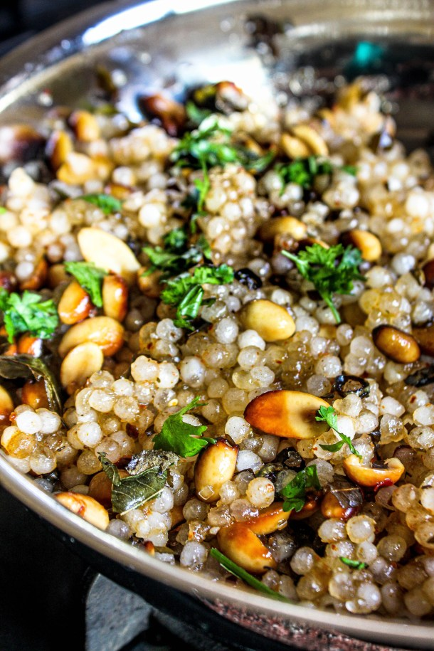 Sabudana khichdi (tapioca pearls) tossed in roasted peanuts served in a silver stainless steel dish
