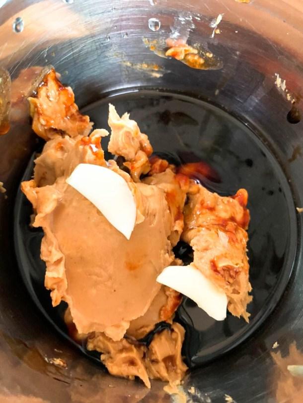 peanut butter, garlic, soy sauce, water, sriracha in a blender