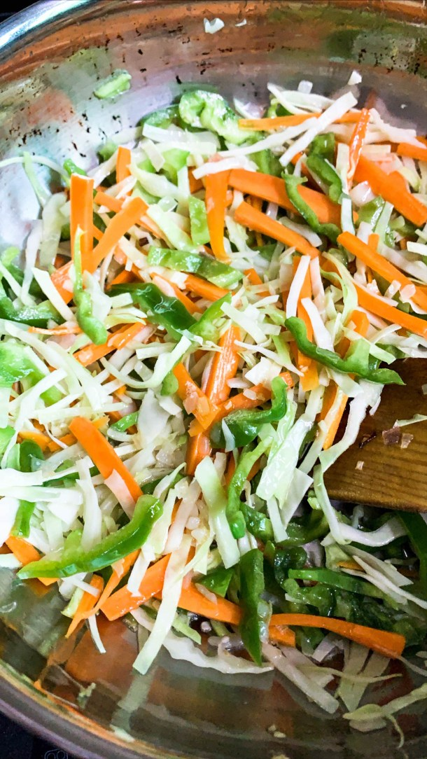 Shredded capsicum, carrots and cabbage in a pan