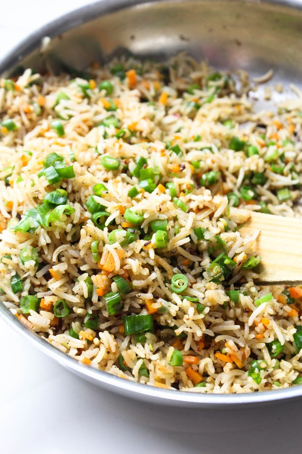 Ginger Garlic Fried Rice with Vegetables in a large frying pan, placed on a white tile.