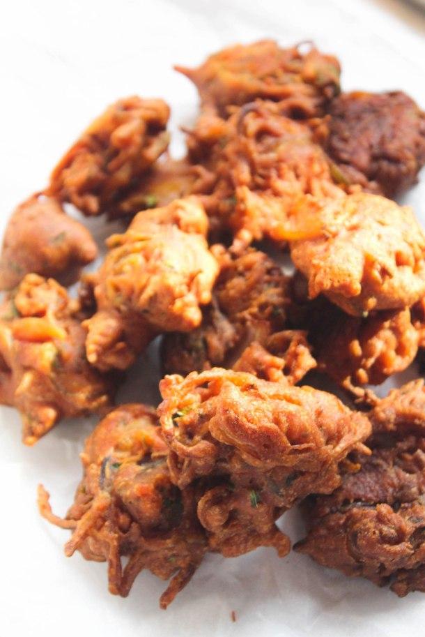 Deep fried golden brown onion pakodas (pakoras/ bhajia) popular indian appetiser recipe