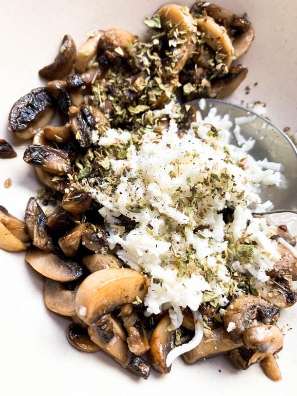 Mushrooms, cheese and garlic mixture in a bowl.