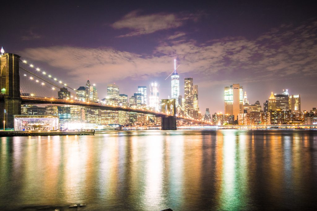 A shot from Dumbo, Brooklyn Bridge, Jane's Carousel and the Manhattan Skyline at Night