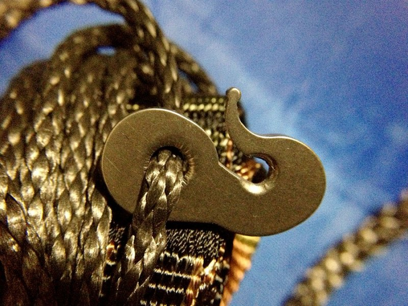 The titanium Whoopie Hook is another minuscule device that takes the place of a full-size climbing carabiner, often used to connect a hammock to a webbing strap. Simple, straightforward, strong.