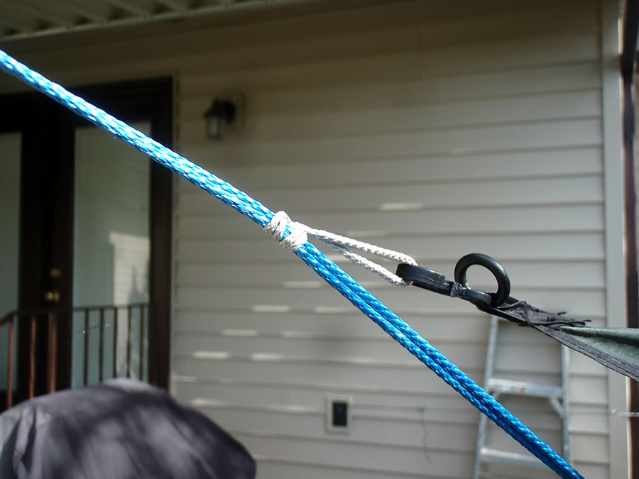 One way to use a Prusik knot: an adjustable connection point for a tarp.