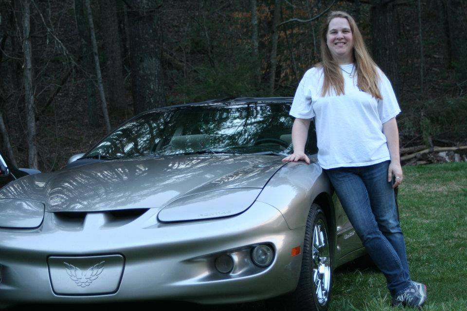 Image of Writer Bethany Orr Standing next to a sports car.