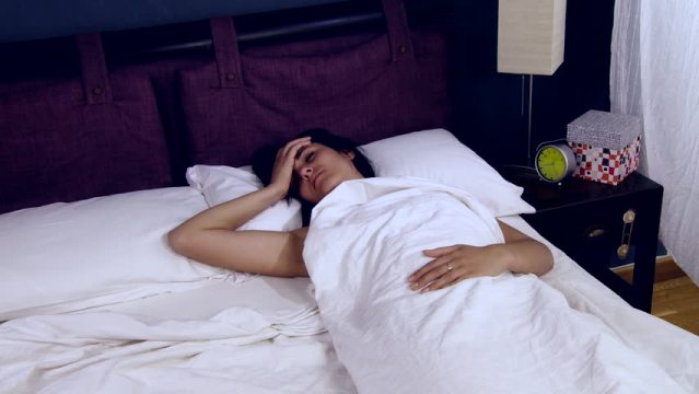 Living with Fibromyalgia - woman in bed