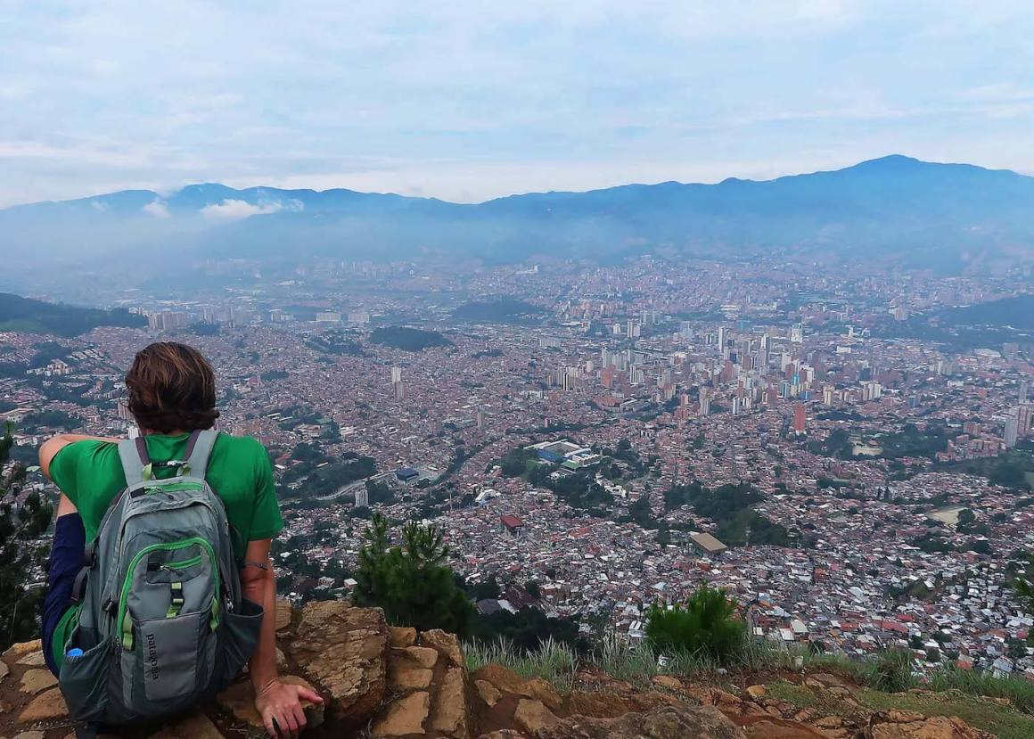 Chris looking down at Medellin view