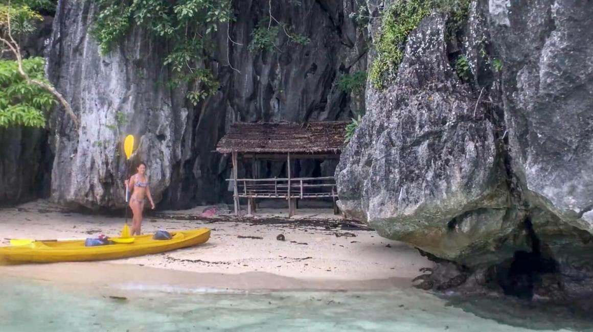 Kim and the kayak on a little beach on Coron Island.