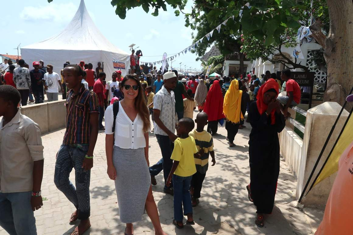 Kim blending in with the locals in Lamu Town, while backpacking in Kenya