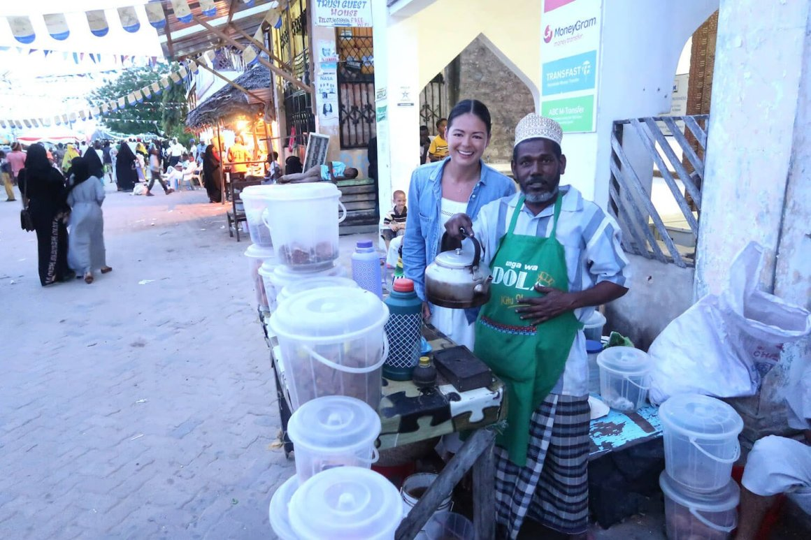 Kim and the spiced coffee man in Lamu