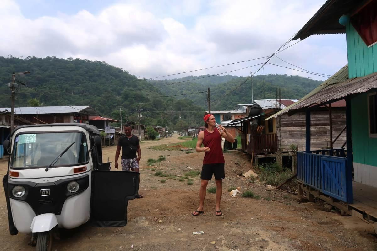 chris sipping homemade liquor in bahia solano town
