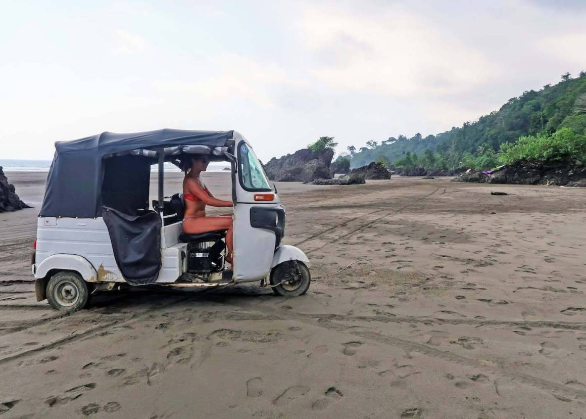 Kim driving a tuk-tuk on Playa El Almejal, which is highlighted in our list of things to do in El Valle, Choco, Colombia