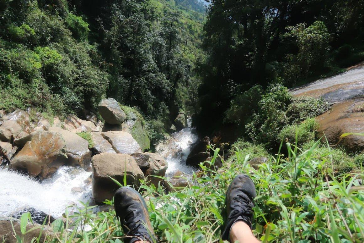 Chris' feet and looking down Quebrada del Hato