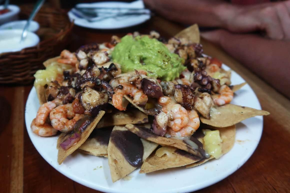 octopus and shrimp seafood nachos at barracuda in tulum mexico