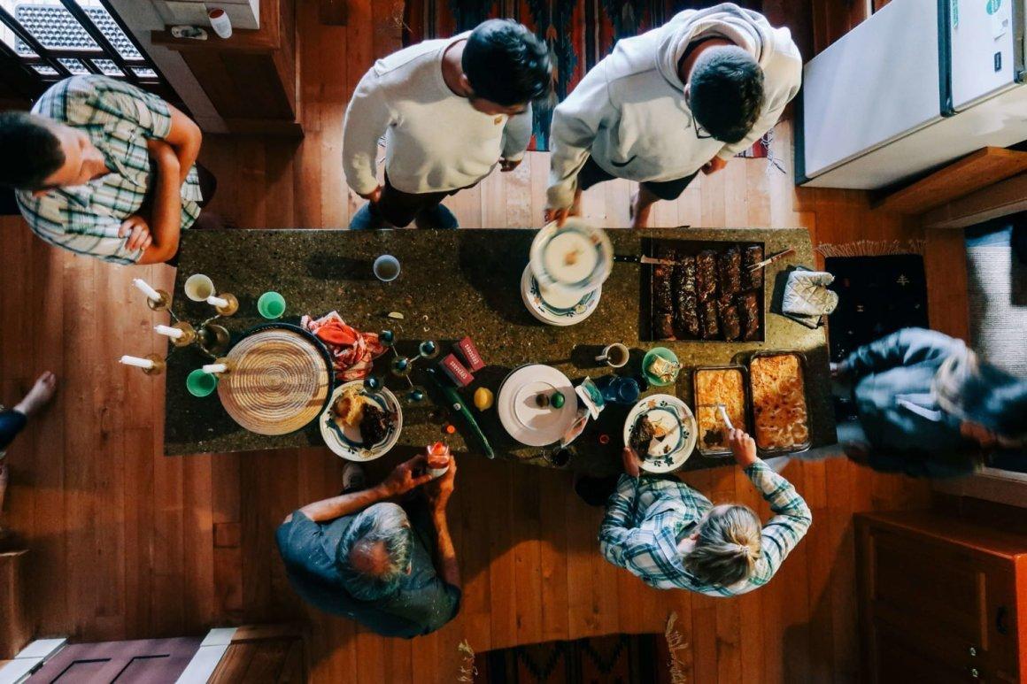 group eating kitchen island savary island