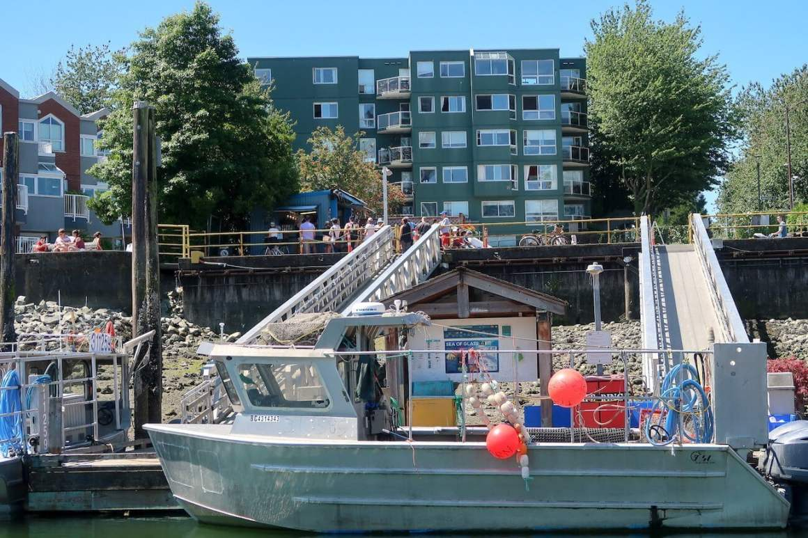 Fishing boat in foreground with Go Fish in background