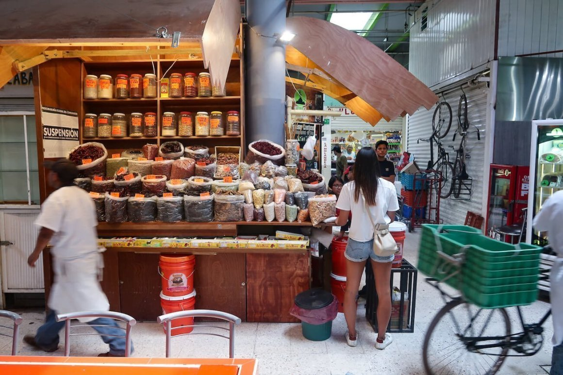 Kim at a stall in Mexico City's San Juan market