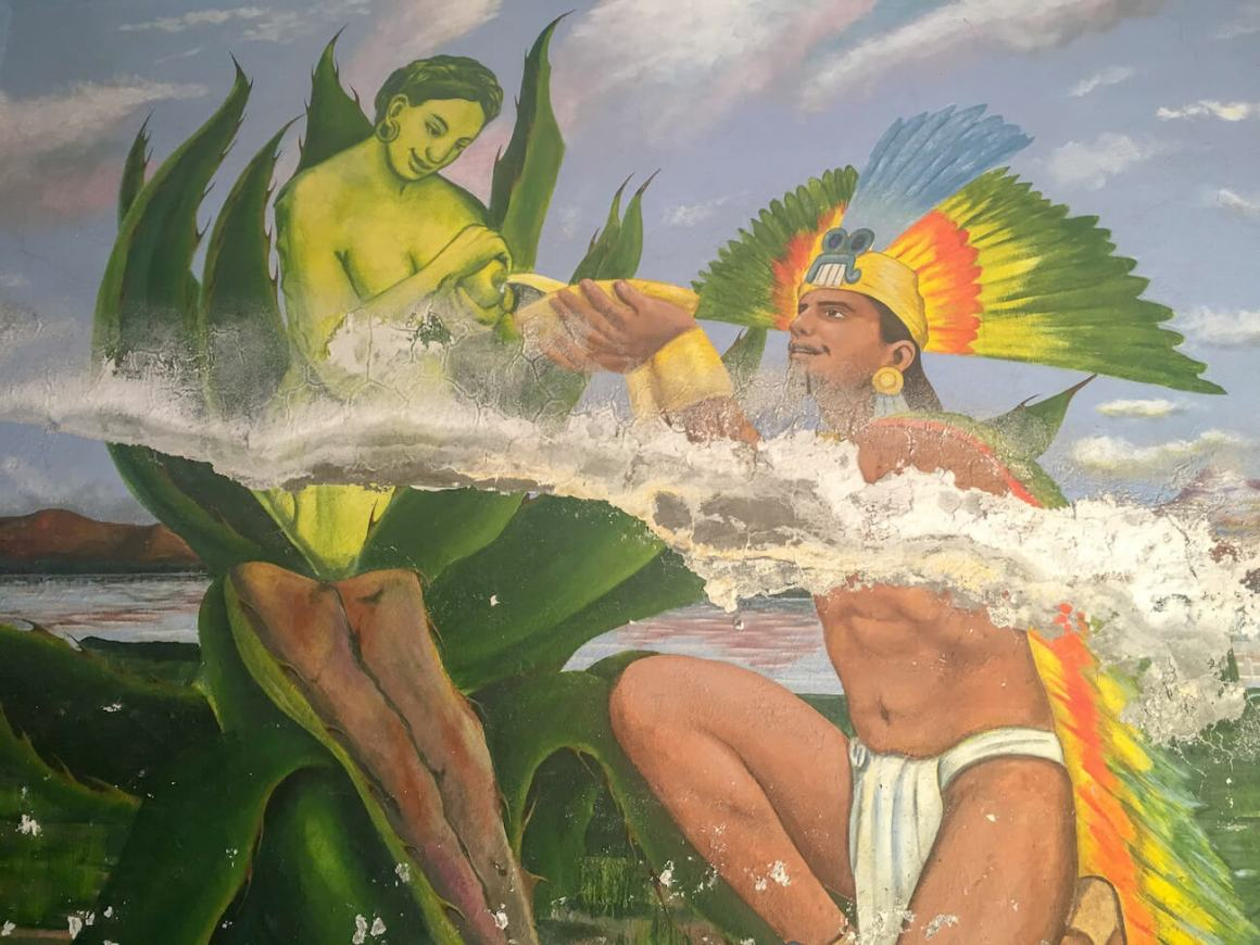 Painting of Aztec getting pulque from breast of goddess of pulque