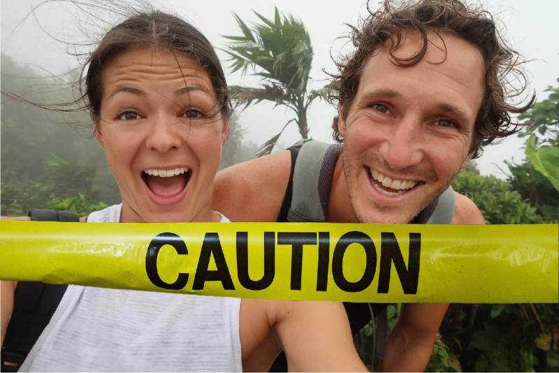 Do not work with us cover image of Chris and Kim behind caution tape