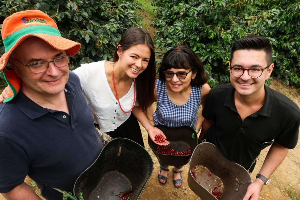 kims family showing us their freshly picked coffee fruit at finca la leona in envigado