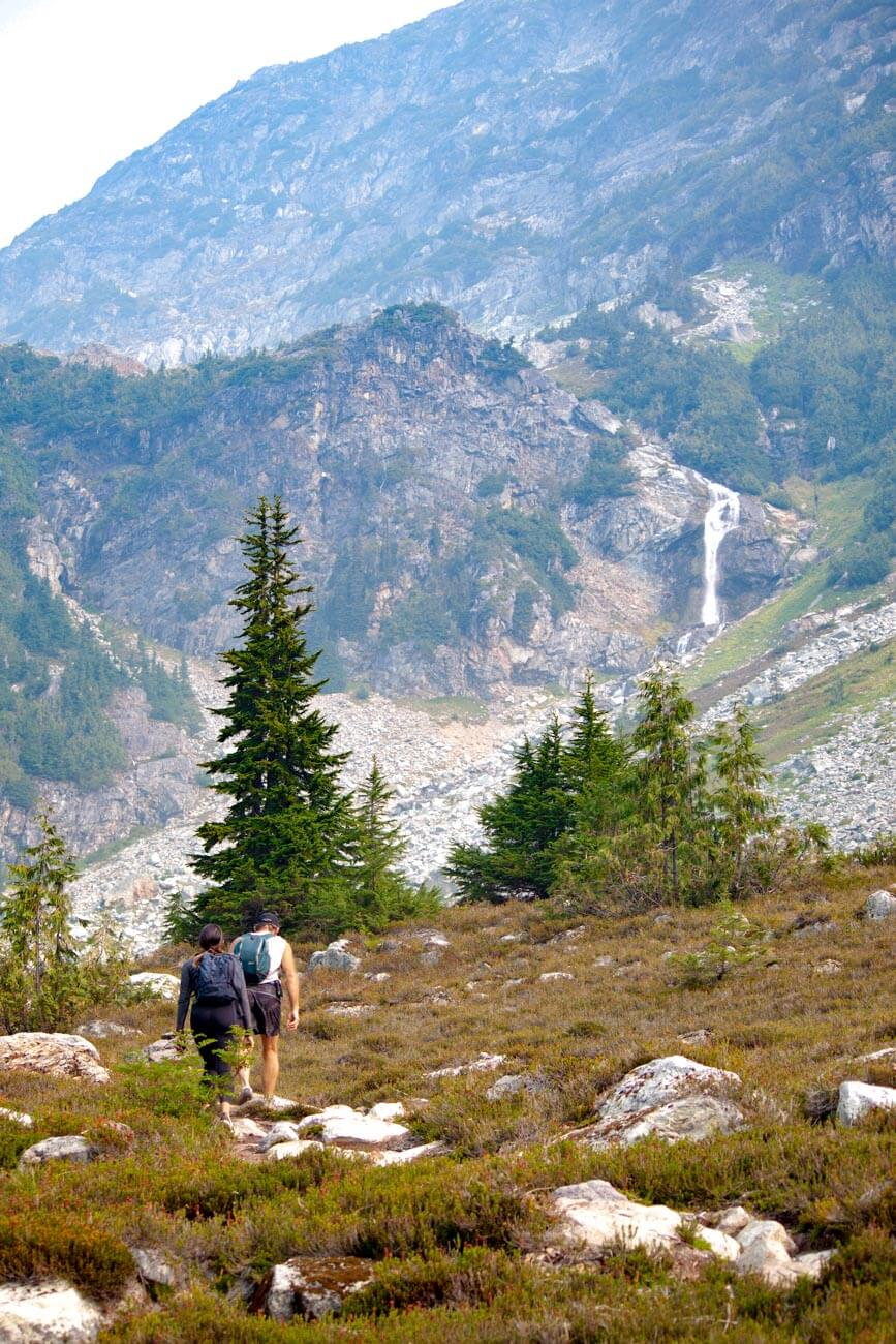 Hiking along Brandywine Meadows with waterfall in background