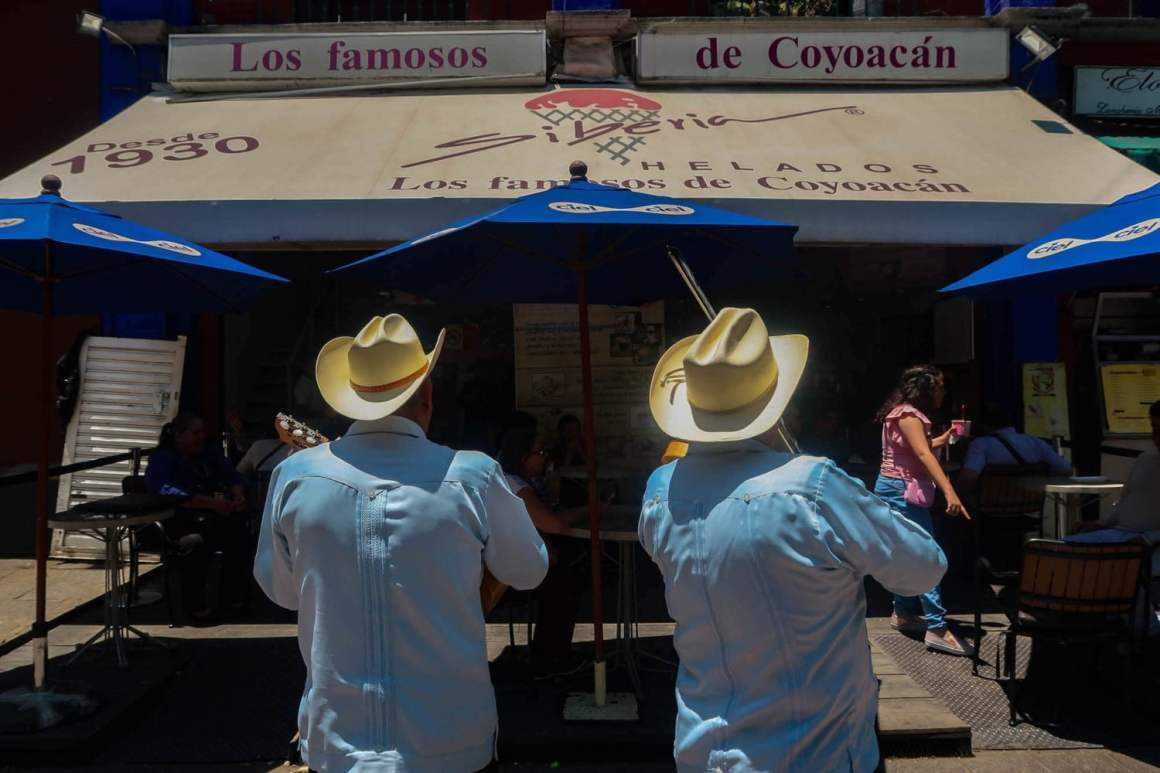 Mexico City travel blog cover of musicians in Coyoacan