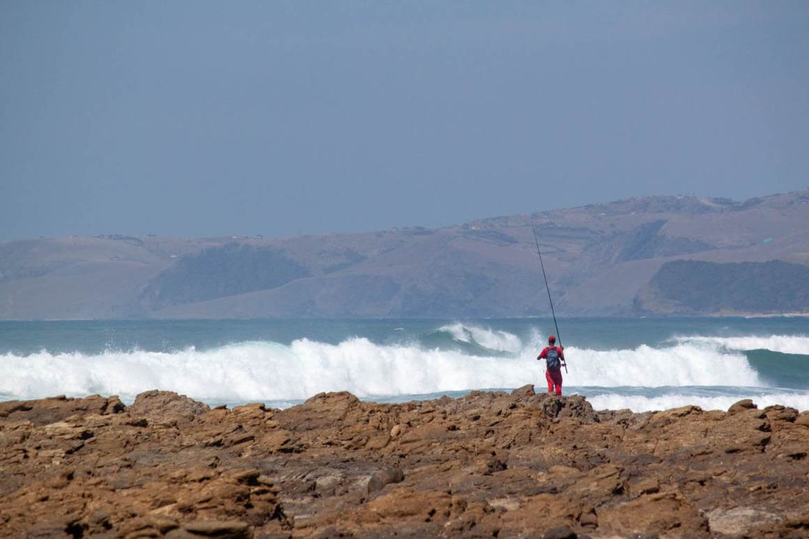 Man fishing on the shore of the Wild Coast