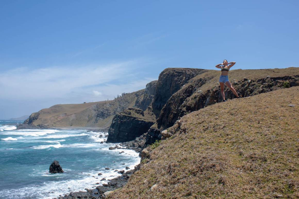 Cover image of Kim posing on a hike from Mdumbi to Coffee Bay on the Wild Coast