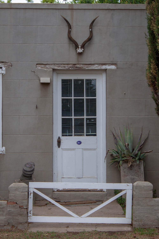 Door and antlers above in Nieu Bethesda