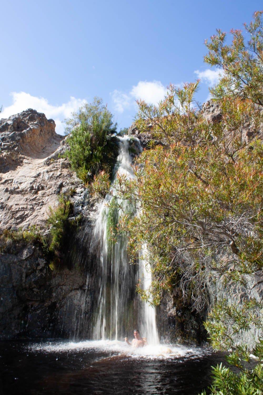 Chris swimming in Oakes Falls