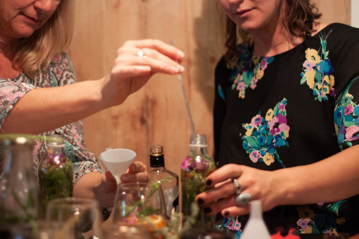 filling up our homemade gins with vodka cape town food experience must do
