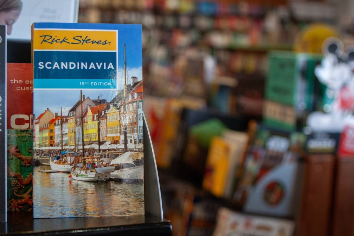 A Rick Steves travel guide on a bookstore shelf.