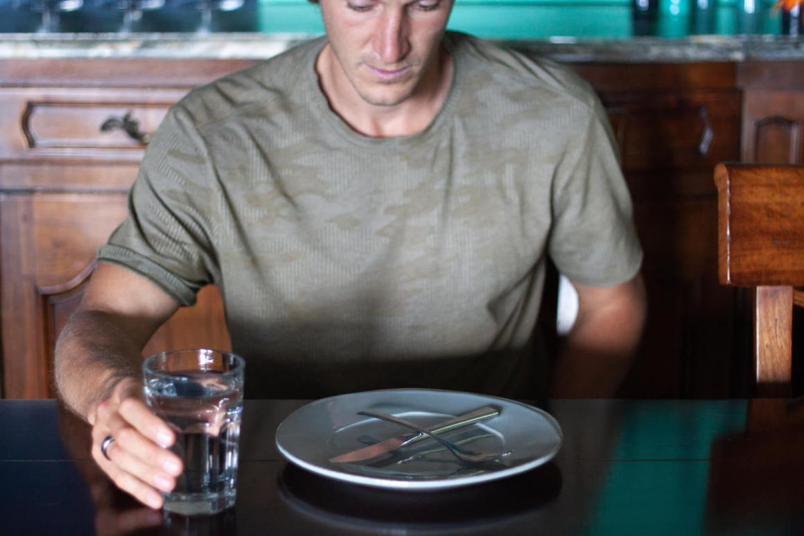 Chris staring at empty plate.