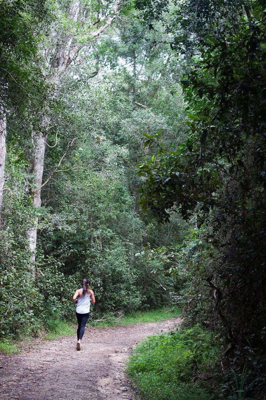 Kim runs through the forest in Knsyna.