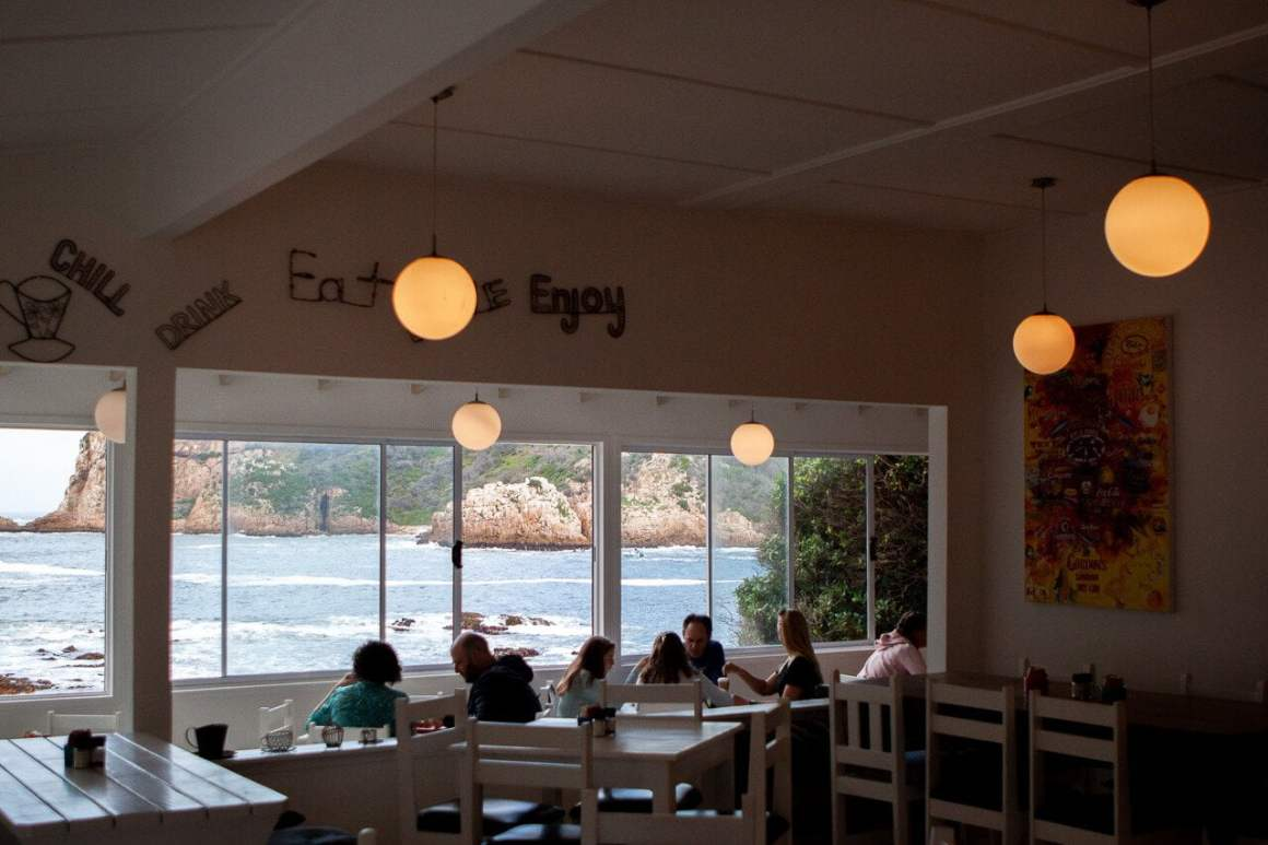 Hungry diners at East Head Cafe in Kynsna with views of the lagoon in the background.