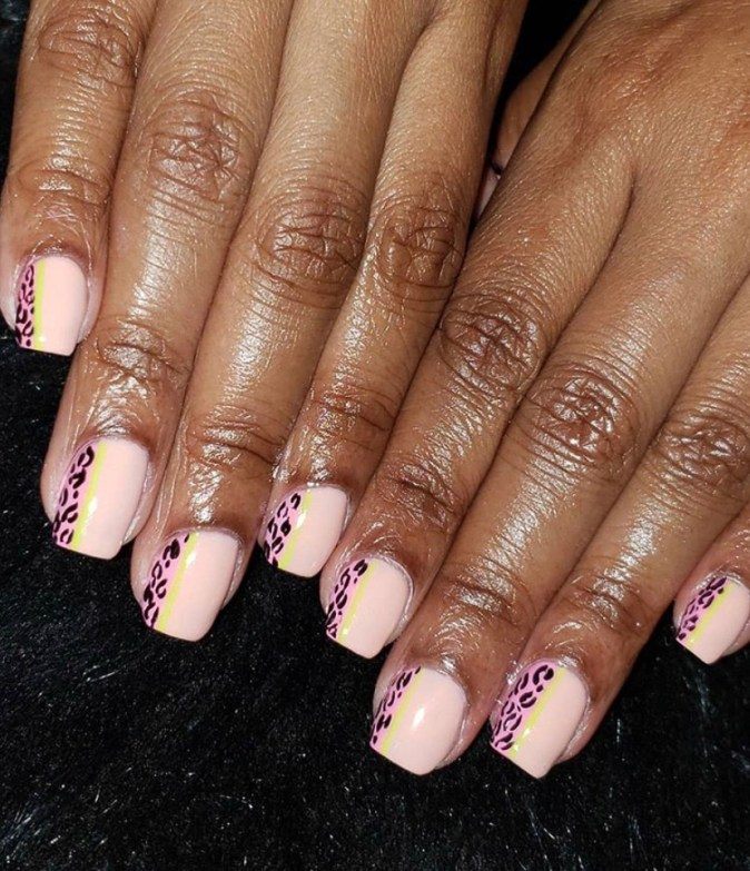 Short square shaped nude acrylic nails with cheetah print accents