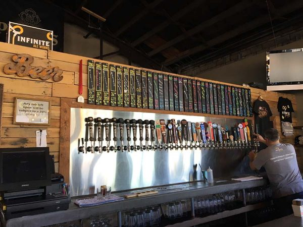 picture of taps at Infinite Ale Works where they have beer yoga