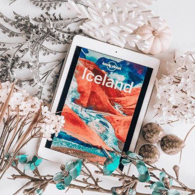 Bookstagram picture of Lonely Planet Iceland travel guide with flowers