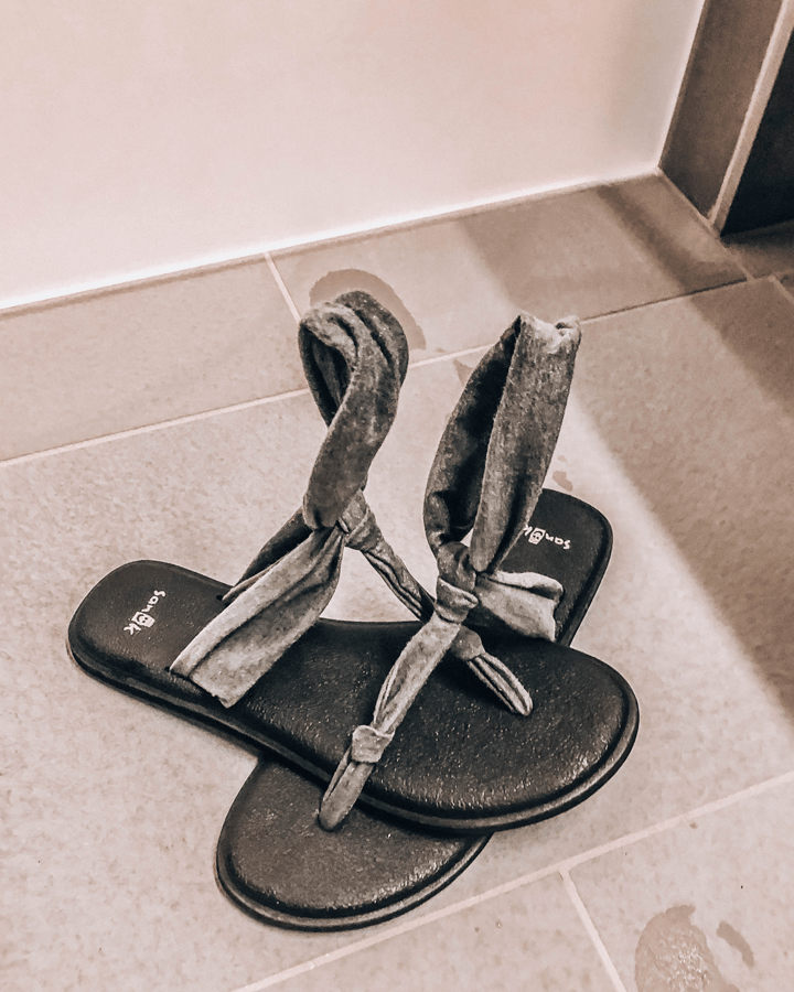 frozen grey sandals on the shower room floor of The Blue Lagoon Retreat and Spa