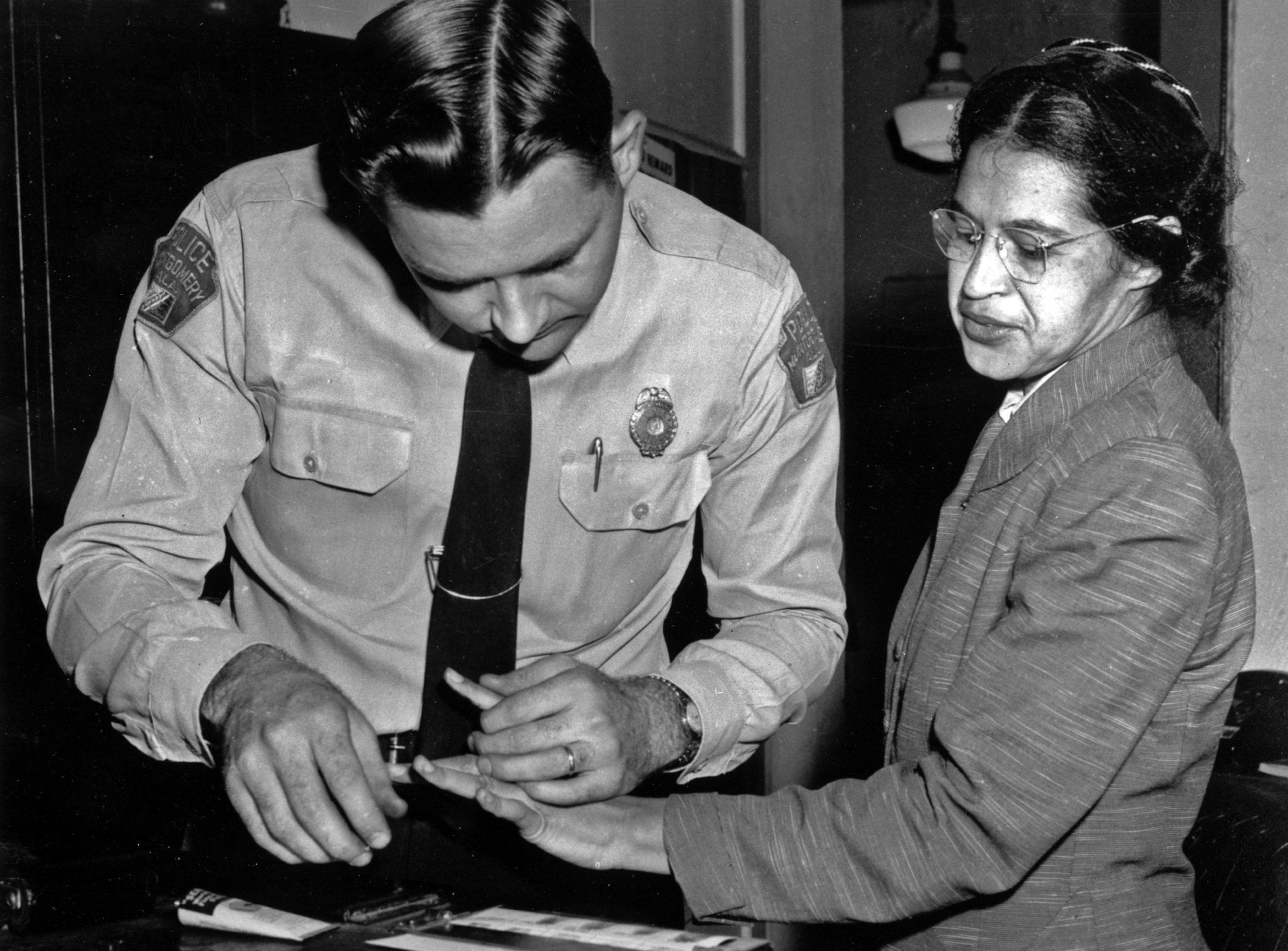 hight resolution of rosa parks is fingerprinted by police