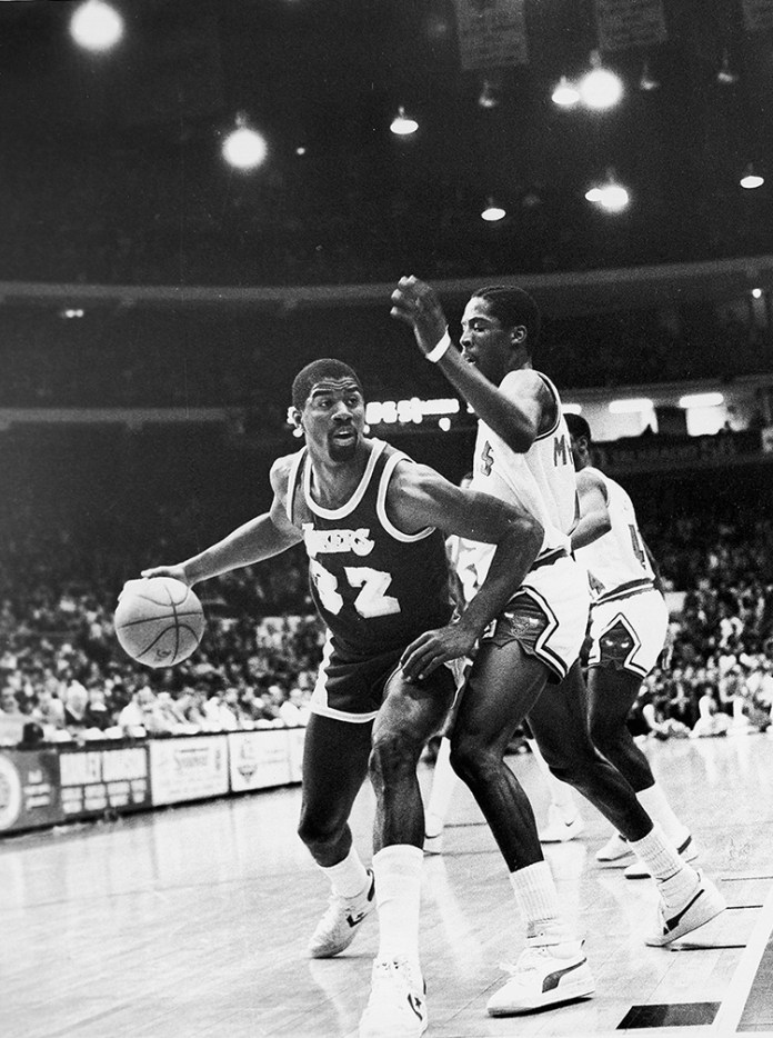 "34ba1d5bc Earvin ""Magic"" Johnson (left) drives past Wes Matthews (right) during a game  between the Los Angeles Lakers and Chicago Bulls on Feb. 20"